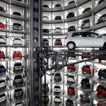 WOLFSBURG, GERMANY - MARCH 11:  Cars by German automaker Volkswagen AG stand parked in one of two towers at the Autostadt customer reception center at the Volkswagen factory on the day of VW's annual press conference on March 11, 2010 in Wolfsburg, Germany. VW Chairman Martin Winterkorn admitted that VW had been affected by the worldwide financial crisis in 2009, though reported that many of VW's brands reported growth, especially in China. VW customers who come to Wolfsburg to pick up their car in person receive their new car after a robot extracts the car from one of the two towers and brings it to them via an automated, underground transport system. Each of the two towers hold 400 cars.  (Photo by Sean Gallup/Getty Images)